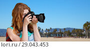 Купить «woman with backpack and camera over venice beach», фото № 29043453, снято 25 июля 2015 г. (c) Syda Productions / Фотобанк Лори