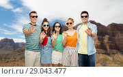 friends in sunglasses showing ok over grand canyon. Стоковое фото, фотограф Syda Productions / Фотобанк Лори