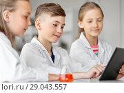 Купить «kids with tablet pc at school laboratory», фото № 29043557, снято 19 мая 2018 г. (c) Syda Productions / Фотобанк Лори