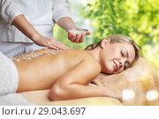 Купить «woman having salt massage in spa», фото № 29043697, снято 18 декабря 2014 г. (c) Syda Productions / Фотобанк Лори