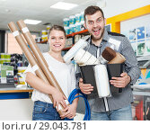 Купить «Happy couple demonstration variety instruments for repair house», фото № 29043781, снято 17 мая 2018 г. (c) Яков Филимонов / Фотобанк Лори