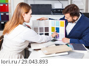 Купить «Competent seller in showroom helping young female client to choose furniture materials for her apartment», фото № 29043893, снято 9 апреля 2018 г. (c) Яков Филимонов / Фотобанк Лори