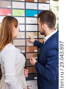 Купить «Competent seller in showroom helping young female client to choose furniture materials for her apartment», фото № 29043897, снято 9 апреля 2018 г. (c) Яков Филимонов / Фотобанк Лори