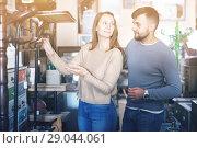 Купить «Couple looking for hallstand in shop», фото № 29044061, снято 9 ноября 2017 г. (c) Яков Филимонов / Фотобанк Лори