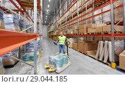 Купить «male worker with loader and clipboard at warehouse», фото № 29044185, снято 9 декабря 2015 г. (c) Syda Productions / Фотобанк Лори