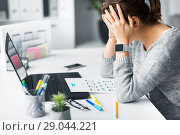Купить «stressed web designer with user interface layout», фото № 29044221, снято 17 января 2018 г. (c) Syda Productions / Фотобанк Лори