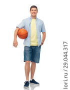Купить «smiling young man with basketball», фото № 29044317, снято 30 июня 2018 г. (c) Syda Productions / Фотобанк Лори