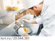 Купить «happy male chef cooking food at restaurant kitchen», фото № 29044381, снято 2 апреля 2017 г. (c) Syda Productions / Фотобанк Лори
