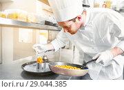 Купить «happy male chef cooking food at restaurant kitchen», фото № 29044385, снято 2 апреля 2017 г. (c) Syda Productions / Фотобанк Лори