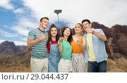Купить «friends taking selfie over grand canyon», фото № 29044437, снято 30 июня 2018 г. (c) Syda Productions / Фотобанк Лори