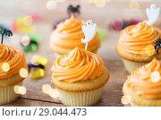 Купить «halloween party cupcakes or muffins on table», фото № 29044473, снято 6 июля 2017 г. (c) Syda Productions / Фотобанк Лори