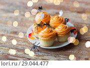 Купить «halloween party cupcakes or muffins on table», фото № 29044477, снято 6 июля 2017 г. (c) Syda Productions / Фотобанк Лори