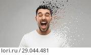 Купить «crazy shouting man in t-shirt over gray background», фото № 29044481, снято 15 января 2016 г. (c) Syda Productions / Фотобанк Лори