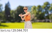 Купить «happy teenage girl with racket playing tennis», фото № 29044701, снято 30 июня 2018 г. (c) Syda Productions / Фотобанк Лори