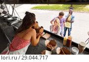 Купить «customers queue and saleswoman at food truck», фото № 29044717, снято 1 августа 2017 г. (c) Syda Productions / Фотобанк Лори