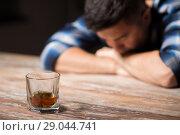 Купить «drunk man with glass of alcohol on table at night», фото № 29044741, снято 24 ноября 2017 г. (c) Syda Productions / Фотобанк Лори