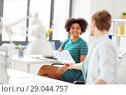 Купить «creative office workers with user interface mockup», фото № 29044757, снято 11 марта 2018 г. (c) Syda Productions / Фотобанк Лори