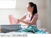 Купить «woman or housewife sorting laundry at home», фото № 29044805, снято 29 апреля 2018 г. (c) Syda Productions / Фотобанк Лори
