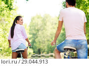 Купить «happy couple with bicycles at summer park», фото № 29044913, снято 15 июля 2018 г. (c) Syda Productions / Фотобанк Лори