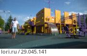 Купить «Defocused summer children playground with kids and parents. HD 1080 fast motion», видеоролик № 29045141, снято 23 февраля 2019 г. (c) Dmitry Domashenko / Фотобанк Лори
