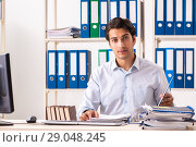 Купить «Young handsome businessman working in office», фото № 29048245, снято 7 июля 2018 г. (c) Elnur / Фотобанк Лори