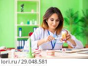 Купить «Woman dentist working on teeth implant», фото № 29048581, снято 11 июня 2018 г. (c) Elnur / Фотобанк Лори