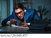 Купить «Young business playing cards late in office», фото № 29049477, снято 9 октября 2017 г. (c) Elnur / Фотобанк Лори