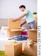 Купить «Young man moving to new apartment», фото № 29049773, снято 30 июня 2018 г. (c) Elnur / Фотобанк Лори