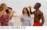Купить «friends clinking non alcoholic drinks on beach», видеоролик № 29050113, снято 24 августа 2018 г. (c) Syda Productions / Фотобанк Лори