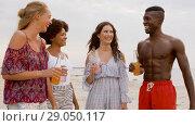 Купить «friends with non alcoholic drinks on beach», видеоролик № 29050117, снято 24 августа 2018 г. (c) Syda Productions / Фотобанк Лори
