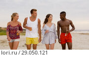 Купить «friends with non alcoholic drinks walking on beach», видеоролик № 29050121, снято 24 августа 2018 г. (c) Syda Productions / Фотобанк Лори