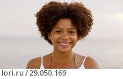 Купить «happy african american young woman outdoors», видеоролик № 29050169, снято 24 августа 2018 г. (c) Syda Productions / Фотобанк Лори