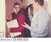 Купить «Guy is saying goodbye his father when is leaving to school», фото № 29050425, снято 5 февраля 2018 г. (c) Яков Филимонов / Фотобанк Лори