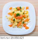 Купить «Top view of salmon omelette», фото № 29050621, снято 20 сентября 2018 г. (c) Яков Филимонов / Фотобанк Лори