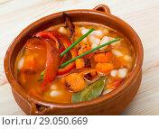 Купить «Soup of bean with boiled carrots, pepper and greens, served in bowl», фото № 29050669, снято 20 октября 2018 г. (c) Яков Филимонов / Фотобанк Лори