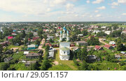 Купить «Flight of the camera over the ancient Orthodox Church. The Church of the Trinity, Totma, Russia. Architectural forms reminiscent of a ship. View of the church in daylight and clear weather», видеоролик № 29051157, снято 16 августа 2018 г. (c) Mikhail Starodubov / Фотобанк Лори
