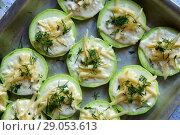 Купить «raw zucchini with cheese and dill on baking sheet», фото № 29053613, снято 3 июля 2018 г. (c) Володина Ольга / Фотобанк Лори