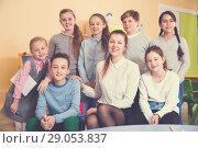 Купить «Friendly group of pupils with teacher in schoolroom», фото № 29053837, снято 28 января 2018 г. (c) Яков Филимонов / Фотобанк Лори