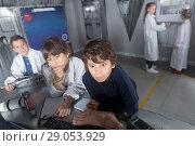 Купить «children solve tasks in the bunker quest room», фото № 29053929, снято 21 октября 2017 г. (c) Яков Филимонов / Фотобанк Лори