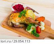 Купить «Poultry dish with cranberry sauce», фото № 29054113, снято 21 июля 2019 г. (c) Яков Филимонов / Фотобанк Лори