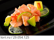 Купить «Salmon ceviche with avocado and lime», фото № 29054125, снято 22 августа 2019 г. (c) Яков Филимонов / Фотобанк Лори