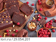 Купить «chocolate buckwheat pound cake cut in slices», фото № 29054201, снято 13 августа 2018 г. (c) Oksana Zh / Фотобанк Лори