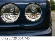 Купить «Headlights luxury of blue car», фото № 29054745, снято 21 августа 2011 г. (c) Юрий Бизгаймер / Фотобанк Лори