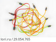 Купить «Color wires with plugs», фото № 29054765, снято 30 августа 2015 г. (c) Юрий Бизгаймер / Фотобанк Лори