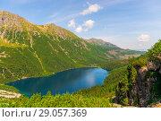 Купить «View from the mountain to the beautiful scenic Lake Morskie Oko on a sunny summer day», фото № 29057369, снято 18 августа 2017 г. (c) Константин Лабунский / Фотобанк Лори