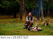 Купить «Wanderlust and Travel concept. Woman roast marshmallow candies on the campfire in forest. Spring or autumn camping», фото № 29057521, снято 6 октября 2016 г. (c) Евгений Глазунов / Фотобанк Лори