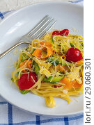 Купить «Homemade pasta with strips of zucchini and carrots», фото № 29060301, снято 7 августа 2018 г. (c) Марина Сапрунова / Фотобанк Лори