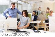 Купить «Chief executive explaining task to female», фото № 29060757, снято 1 августа 2018 г. (c) Яков Филимонов / Фотобанк Лори