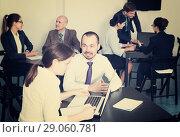 Купить «Employees having a productive day at work», фото № 29060781, снято 28 октября 2016 г. (c) Яков Филимонов / Фотобанк Лори