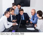 Купить «Coworkers having a productive day at work», фото № 29060789, снято 28 октября 2016 г. (c) Яков Филимонов / Фотобанк Лори